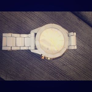 Nixon white classic style watch with gold metal